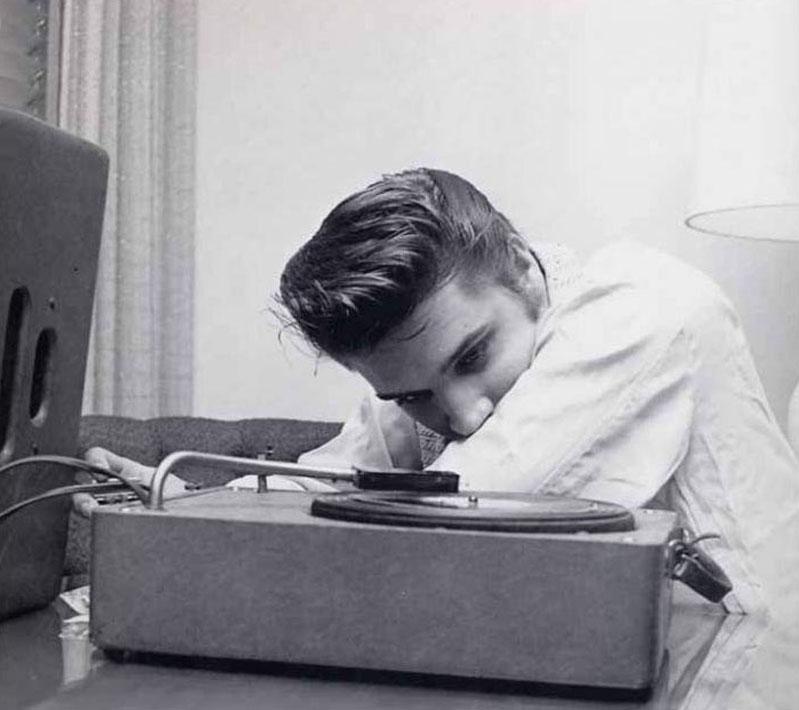 elvis-listening-to-music-in-his-room-by-alfred-wertheimer-1956.jpg