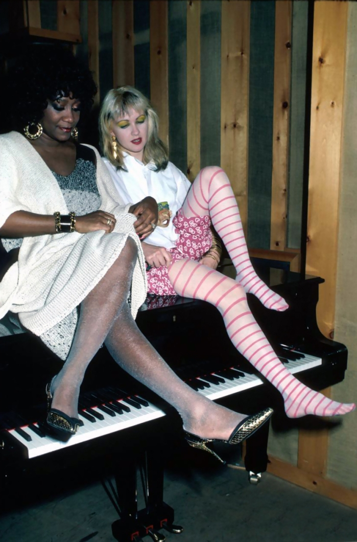 l-r-singers-patti-labelle-and-cyndi-lauper-sitting-on-piano-1996-ann-clifford.jpeg