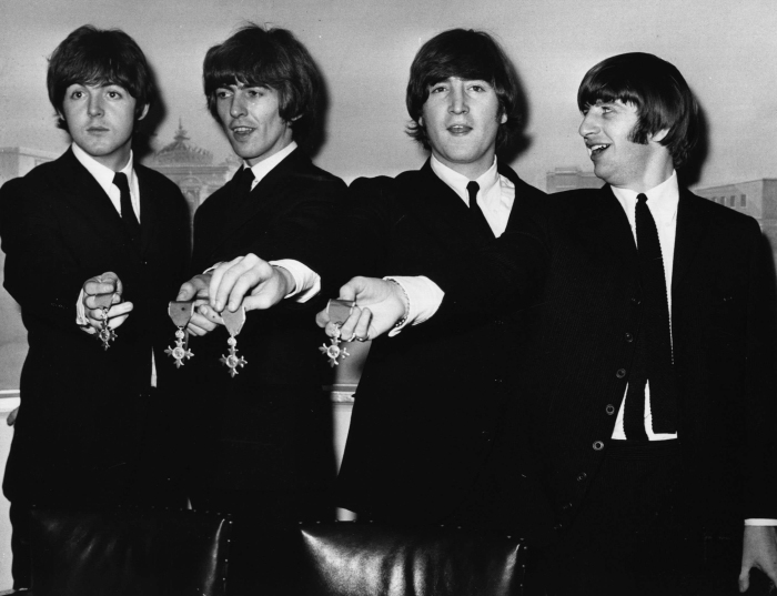 the-beatles-pose-with-their-medals-during-a-press-conference-in-london-after-being-made-members-of-the-order-of-the-british-empire-oct-26-1965.jpg
